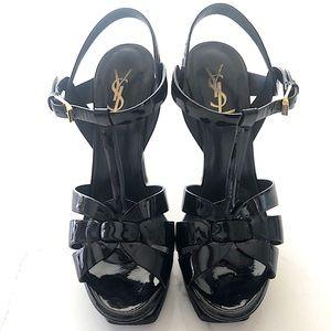 Saint Laurent's black patent sandal.